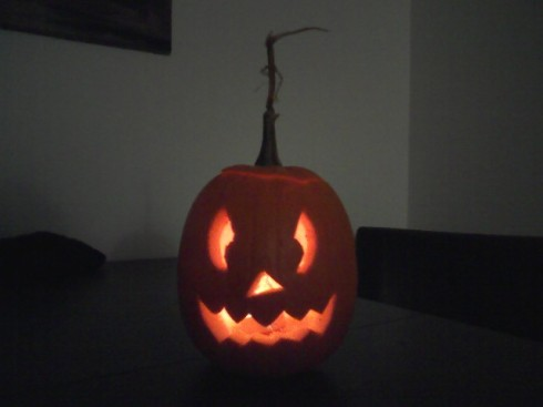 "Our first jack-o-lantern, made by Wittler from an ""accidental"" pumpkin we got from Mark & Mel"